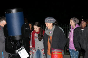 Students and parents at Pascoe Vale Girls College ready to view Saturn through the telescope